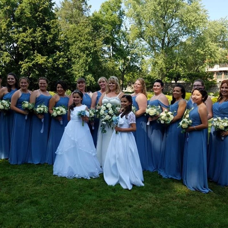 Her family and closest friends standing up at her wedding.  What a lineup!