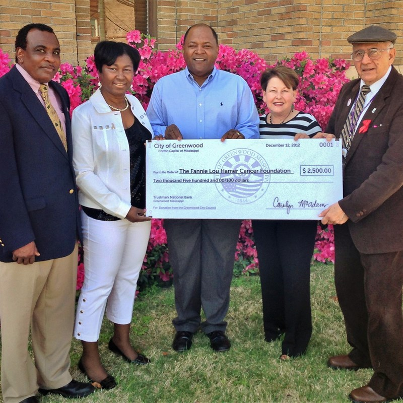 Carolyn and city councilmembers present a check to the Fannie Lou Hamer Cancer Foundation.