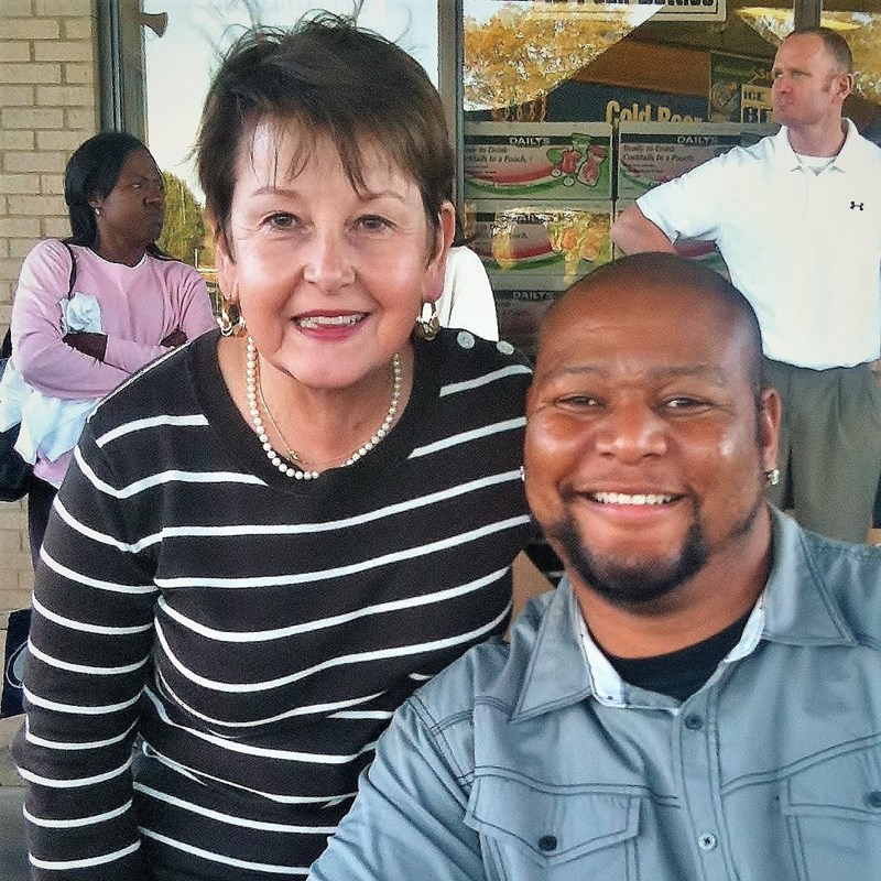 Carolyn welcomes football great Deuce McAllister to an event in Greenwood.