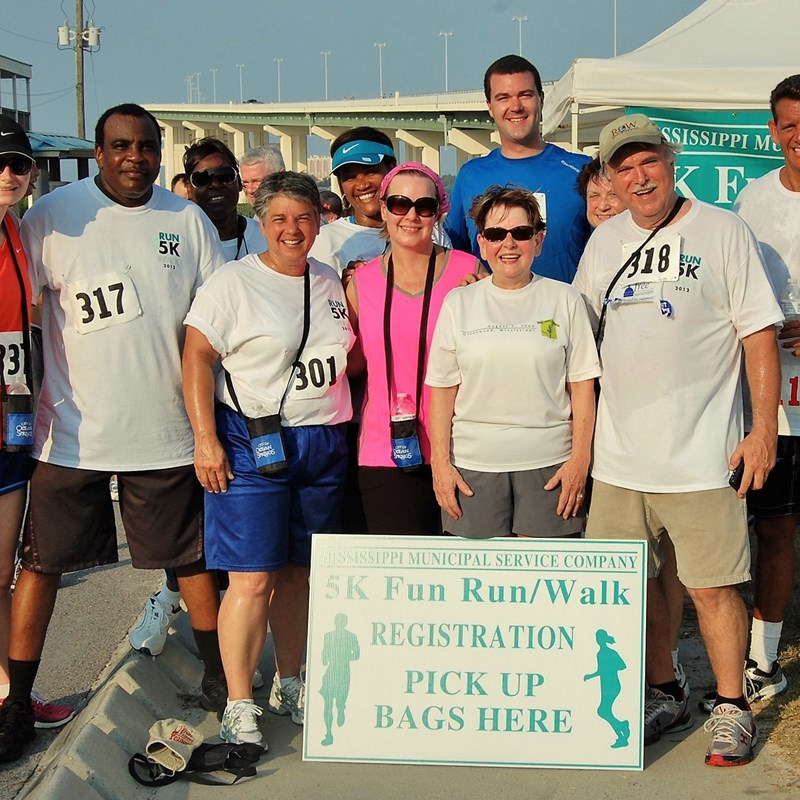 Carolyn and City of Greenwood employees celebrate at the MML 5K run.