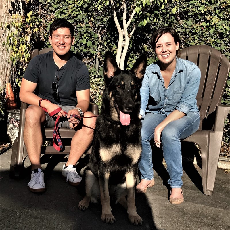 Alex's son (Ian) and daughter-in-law (Molly) with one of the two rescue German shepherds they have welcomed into their home!