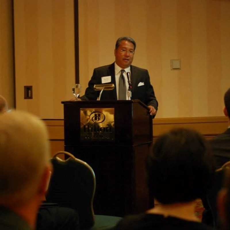 Ross Chun spoke at the 2014 ACCOC forum on Sustainable Energy Practices in membership cities.